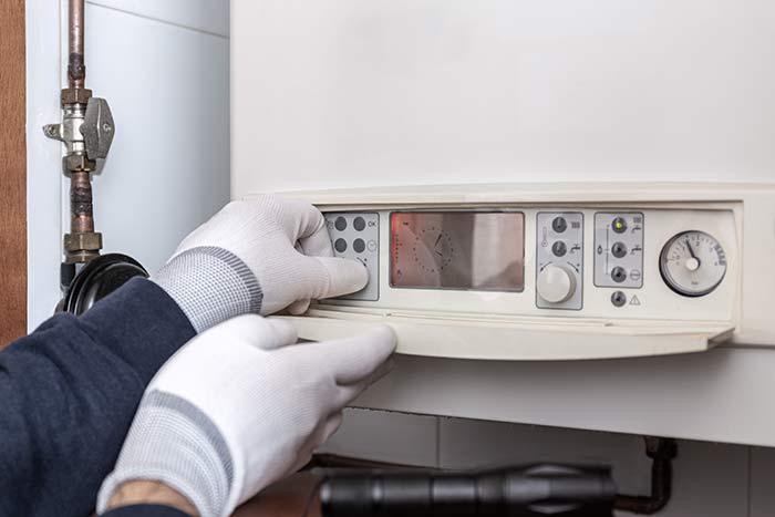 Technician Servicing Heating Boiler In A House Oldbury