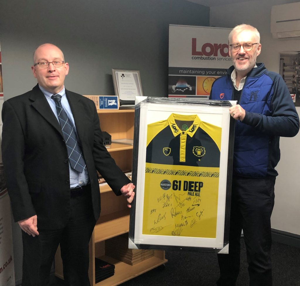 Warwickshire County Cricket Club Chief Executive Stuart Cain (right) Presents Signed Birmingham Bears T20 Shirt To Lord Combustion Services Md Stuart Smith